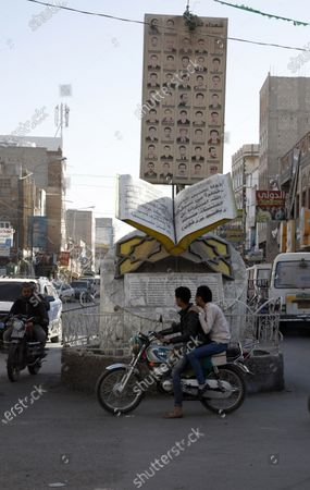 Yemenis ride motorcycles past the memorial to dozens of slain protesters of the 2011 Arab Spring uprising at a street where a two-year-long 2011-uprising protest camp was set up, ahead of the tenth anniversary of the uprising, in Sana'a, Yemen, 20 January 2021 (issued 27 January 2021). Yemen on 27 January 2021 marks the 10th anniversary of the 2011 Arab Spring uprising that toppled the then-president Ali Abdullah Saleh.