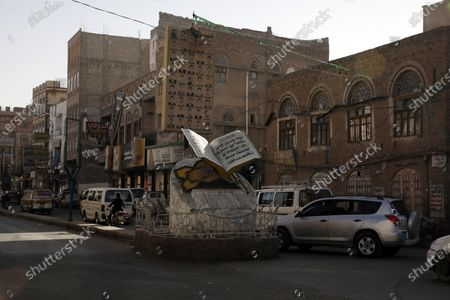 Vehicles drive past the memorial to dozens of slain protesters of the 2011 Arab Spring uprising at a street where a two-year-long 2011-uprising protest camp was set up, ahead of the tenth anniversary of the uprising, in Sana'a, Yemen, 20 January 2021 (issued 27 January 2021). Yemen on 27 January 2021 marks the 10th anniversary of the 2011 Arab Spring uprising that toppled the then-president Ali Abdullah Saleh.