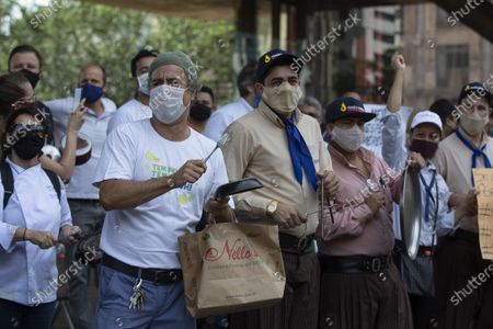 Restaurants and bar workers protest restrictions imposed by the Sao Paulo state government to help contain the spread of the new coronavirus in Sao Paulo, Brazil, . According to new rules imposed by Governor Joao Doria, restaurants and bars can operate normally until 8 p.m. on weekdays and must close on weekends