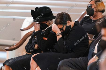 """Stock Photo of Family members, including Billye Aaron, left, and Ceci Aaron, second from left, weep during the funeral services the funeral services for Henry """"Hank"""" Aaron, longtime Atlanta Braves player and Hall of Famer, on at Friendship Baptist Church in Atlanta"""