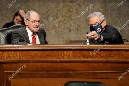 Stock Image of Senate Foreign Relations Committee Chairman Jim Risch (R-Idaho) speaks to Sen. Bob Menendez (D-N.J.) before a confirmation hearing for nominee for United Nations Ambassador Linda Thomas-Greenfield on Capitol Hill