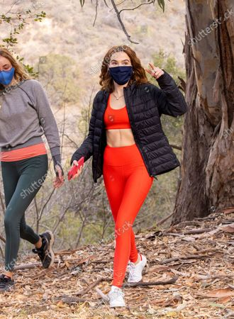 Zoey Deutch stays sporty in an Old Navy twinset while out on a hike.