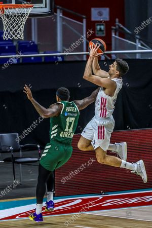 Real Madrid's Carlos Alocen (R) in action against Panathinaikos OPAP's Marcus Foster (L)  during a Euroleague basketball match between Real Madrid and Panathinaikos OPAP at Wizink Center in Madrid, Spain, 27 January 2021.