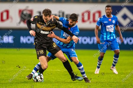 STVV's Facundo Colidio and Gent's Milad Mohammadi fight for the ball during a soccer match between KAA Gent and K Sint-Truiden VV, Wednesday 27 January 2021 in Gent, on day 20 of the 'Jupiler Pro League' first division of the Belgian championship.