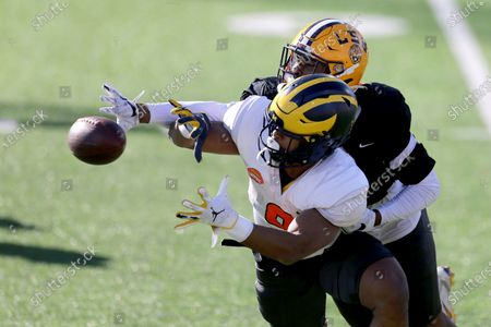 Stock Picture of American Team running back Chris Evans, front, of Michigan, has the ball knocked away by defensive back JaCoby Stevens, of LSU, during the American team practice for the NCAA college football Senior Bowl in Mobile, Ala
