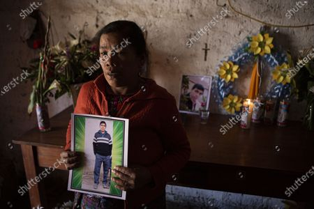 Stock Photo of Elena Marroquin poses for a portrait with a photo of her grandson Rivaldo Danilo Jimenez, in her home in Comitancillo, Guatemala, . She believes that her grandson is one of the 13 of the 19 charred corpses found in a northern Mexico border state on Saturday. The country's Foreign Ministry said it was collecting DNA samples from a dozen relatives to see if there was a match with any of the bodies