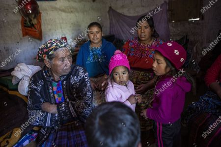 Family and neighbors gather in the home of migrant Rivaldo Jimenez, in Comitancillo, Guatemala, . Jimenez family members believe he may be one of the charred corpses found in a northern Mexico border state on Saturday. The country's Foreign Ministry said it was collecting DNA samples from a dozen relatives to see if there was a match with any of the bodies