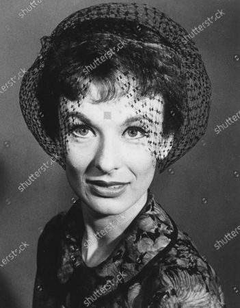 """Stock Image of Actress Cloris Leachman wears a headband hat with black tulip shaped veiling, called a topette by designer Alfred Brod, in May 1959. Leachman, a character actor whose depth of talent brought her an Oscar for the """"The Last Picture Show"""" and Emmys for her comedic work in """"The Mary Tyler Moore Show"""" and other TV series, has died. She was 94"""