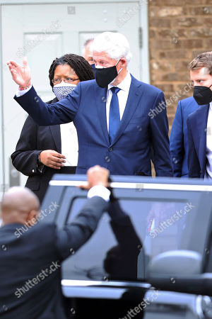 Former President Bill Clinton seen exiting Baseball Hall Of Fame player, Hank Aaron's Funeral Service at Friendship Baptist Church