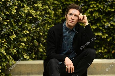 """Stock Picture of Daryl Wein, the co-writer, co-director and co-producer of """"How It Ends"""" with his wife Zoe Lister-Jones, poses for a portrait to promote the film for the Sundance Film Festival, in Los Angeles"""