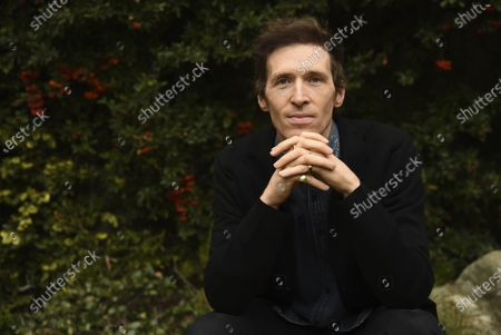 """Daryl Wein, the co-writer, co-director and co-producer of """"How It Ends"""" with his wife Zoe Lister-Jones, poses for a portrait to promote the film for the Sundance Film Festival, in Los Angeles"""