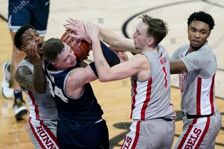 Utah State's Justin Bean battles for the ball with UNLV's David Jenkins Jr., left, Moses Wood (1) and Bryce Hamilton (13) during the second half of an NCAA college basketball game, in Las Vegas