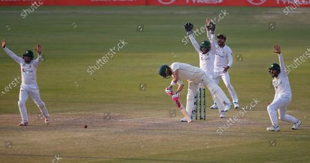 Pakistan's players, left to right, Abid Ali, Mohammad Rizwan, Babar Azam, Imran Butt, appeal for LBW out of South Africa's Faf du Plessis, center front, during the third day of the first cricket test match between Pakistan and South Africa at the National Stadium, in Karachi, Pakistan