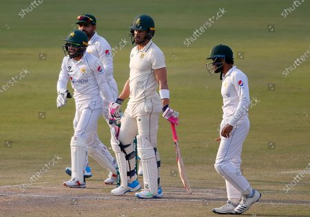 South Africa's Faf du Plessis, center, reacts while Pakistan's Mohammad Rizwan, left front, Babar Azam, second left, and Imran Butt, right, celebrate his dimissial during the third day of the first cricket test match between Pakistan and South Africa at the National Stadium, in Karachi, Pakistan