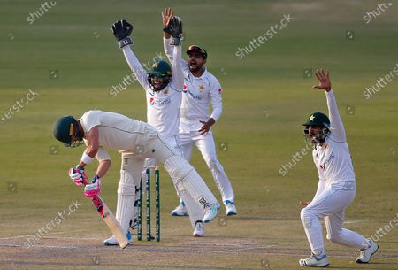 Pakistan's Mohammad Rizwan, center back, Babar Azam, second right, and Imran Butt, right, appeal for LBW out of South Africa's Faf du Plessis, left, during the third day of the first cricket test match between Pakistan and South Africa at the National Stadium, in Karachi, Pakistan