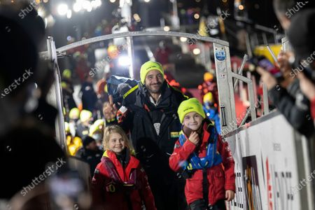 France's Louis Burton arrives after placing third in the Vendee Globe solo around-the-world sailing race, in Les Sables-d'Olonne, western France, early Thursday, Jan.28, 2021