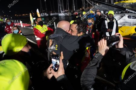 French skipper Louis Burton (C), 35, who sailed his Imoca 60 monohull 'Bureau Vallee' in the 2020/2021 ninth edition of the Vendee Globe round-the-world solo race, celebrates after crossing the finish line at Les Sables d'Olonne, western France, 28 January 28, 2021. French Charlie Dalin completed the epic race in 80 days, six hours, 15 minutes and 47 seconds. However, Germany's Boris Herrmann (SeaExplorer-Yacht Club de Monaco) and France's Yannick Bestaven (Maitre coq IV) are still in the running for the title.