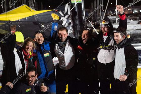 French skipper Louis Burton (3-R), 35, who sailed his Imoca 60 monohull 'Bureau Vallee' in the 2020/2021 ninth edition of the Vendee Globe round-the-world solo race, poses with his wife Servane (L), and members of staff after crossing the finish line at Les Sables d'Olonne, western France, 28 January 2021. French Charlie Dalin completed the epic race in 80 days, six hours, 15 minutes and 47 seconds. However, Germany's Boris Herrmann (SeaExplorer-Yacht Club de Monaco) and France's Yannick Bestaven (Maitre coq IV) are still in the running for the title.