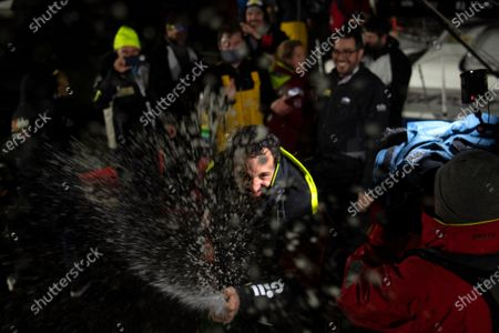 French skipper Louis Burton, 35, who sailed his Imoca 60 monohull 'Bureau Vallee' in the 2020/2021 ninth edition of the Vendee Globe round-the-world solo race, sprays champagne as he celebrates after crossing the finish line at Les Sables d'Olonne, western France, 28 January 2021. French Charlie Dalin completed the epic race in 80 days, six hours, 15 minutes and 47 seconds. However, Germany's Boris Herrmann (SeaExplorer-Yacht Club de Monaco) and France's Yannick Bestaven (Maitre coq IV) are still in the running for the title.