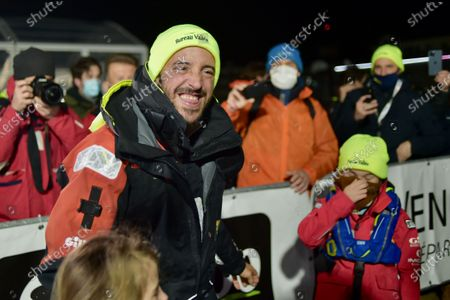 French skipper Louis Burton, 35, who sailed his Imoca 60 monohull 'Bureau Vallee' in the 2020/2021 ninth edition of the Vendee Globe round-the-world solo race, poses for photographers after crossing the finish line at Les Sables d'Olonne, western France, 28 January 2021. French Charlie Dalin completed the epic race in 80 days, six hours, 15 minutes and 47 seconds.