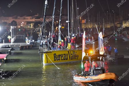 Stock Image of French skipper Louis Burton, 35, who sailed his Imoca 60 monohull 'Bureau Vallee' in the 2020/2021 ninth edition of the Vendee Globe round-the-world solo race, arrives after crossing the finish line at Les Sables d'Olonne, western France, 28 January 2021. French Charlie Dalin completed the epic race in 80 days, six hours, 15 minutes and 47 seconds.