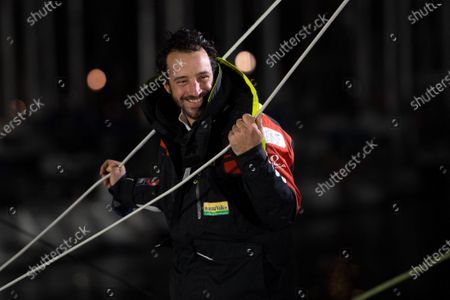 French skipper Louis Burton, 35, who sailed his Imoca 60 monohull 'Bureau Vallee' in the 2020/2021 ninth edition of the Vendee Globe round-the-world solo race, celebrates after crossing the finish line at Les Sables d'Olonne, western France. - French Charlie Dalin completed the epic race in 80 days, six hours, 15 minutes and 47 seconds. However, Germany's Boris Herrmann (SeaExplorer-Yacht Club de Monaco) and France's Yannick Bestaven (Maitre coq IV) are still in the running for the title.