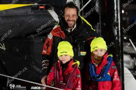 French skipper Louis Burton, 35, who sailed his Imoca 60 monohull 'Bureau Vallee' in the 2020/2021 ninth edition of the Vendee Globe round-the-world solo race, celebrates with his children after crossing the finish line at Les Sables d'Olonne, western France. - French Charlie Dalin completed the epic race in 80 days, six hours, 15 minutes and 47 seconds. However, Germany's Boris Herrmann (SeaExplorer-Yacht Club de Monaco) and France's Yannick Bestaven (Maitre coq IV) are still in the running for the title.
