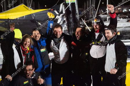 French skipper Louis Burton (3dR), 35, who sailed his Imoca 60 monohull 'Bureau Vallee' in the 2020/2021 ninth edition of the Vendee Globe round-the-world solo race, poses with his wife Servane (L), and members of staff after crossing the finish line at Les Sables d'Olonne, western France. - French Charlie Dalin completed the epic race in 80 days, six hours, 15 minutes and 47 seconds. However, Germany's Boris Herrmann (SeaExplorer-Yacht Club de Monaco) and France's Yannick Bestaven (Maitre coq IV) are still in the running for the title.