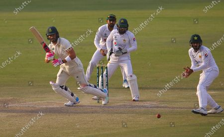 South African batsman Faf du Plessis (L) plays a shot during the third day of the first cricket test match between Pakistan and South Africa in Karachi, Pakistan, 28 January 2021. The South African cricket squad arrived in Pakistan for their first tour consisting of two Test and three T20 matches after a 14-year break.