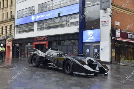 A Batmobile parked outside the Capital Radio studios in London's Leicester Square as a birthday surprise gift for presenter Roman Kemp's 28th birthday. Roman Kemp was gifted a Batmobile as a kid from his godfather George Michael and he still has it. Co-hosts Sonny and Sian are making it a reality for him.