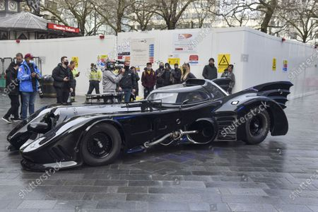 Stock Photo of People look on at the Batmobile outside the Capital Radio studios in London's Leicester Square,  a birthday surprise gift for presenter Roman Kemp's 28th birthday. Roman Kemp was gifted a Batmobile as a kid from his godfather George Michael and he still has it. Co-hosts Sonny and Sian are making it a reality for him.