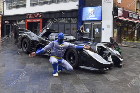 Capital Breakfast co presenter Sunny Jay (R) and presenter Roman Kemp (L) pose next to his surprise Batmobile ride outside the Capital studios for his 28th birthday. Roman Kemp was gifted a Batmobile as a kid from his godfather George Michael and he still has it. Co-hosts Sonny and Sian are making it a reality for him.