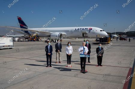 Stock Image of Chilean President Sebastian Pinera speaks in front of the plane carrying containers of the first batch to arrive from China of the CoronaVac vaccine for COVID-19 developed by Chinese biopharmaceutical company Sinovac Biotech at Arturo Merino airport in Santiago, Chile