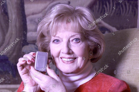 Stock Image of Janet Brown Widow Of Peter Butterworth Also Pictured With A Silver Snuff Box The First Gift Her Husband Gave Her