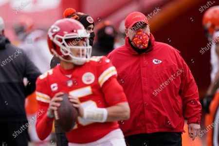 Stock Image of Kansas City Chiefs head coach Andy Reid, right, watches quarterback Patrick Mahomes warm up before an NFL divisional round football game against the Cleveland Browns in Kansas City. On Feb. 7, 2021, the Kansas City Chiefs will be the latest franchise to attempt winning successive Super Bowls when they take on the Buccaneers. In Tampa, of all places. Against Tom Brady, of all people. Only twice since the Patriots pulled off the last repeat in the 2003 and 2004 season has a champion gotten back to the big game. Seattle failed in 2014 against New England, no less; remember Malcolm Butler's goal-line interception? and the Patriots in 2017, the Super Bowl featuring the Philly Special