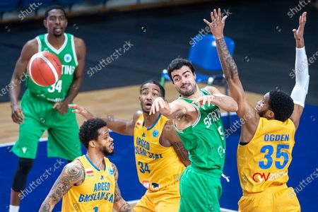 Taurean Green (L), Chris Smith (2L) and Mark Ogden (R) of Arged BMSlam Stal Ostrow Wlkp and Diogo Ventura (2R) of Sporting CP Lisbon in action during the FIBA Europe Cup group C basketball match between Arged BMSlam Stal Ostrow Wlkp. and Sporting CP Lisbon in Wloclawek, central Poland, 28 January 2021.