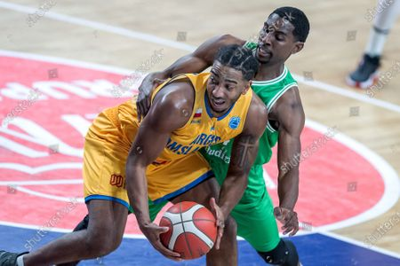 Chris Smith (front) of Arged BMSlam Stal Ostrow Wlkp and James Ellisor (back) of Sporting CP Lisbon in action during the FIBA Europe Cup group C basketball match between Arged BMSlam Stal Ostrow Wlkp. and Sporting CP Lisbon in Wloclawek, central Poland, 28 January 2021.
