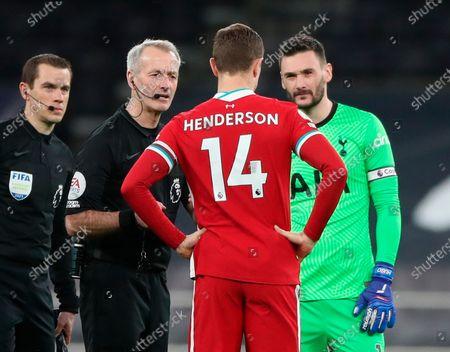 Liverpool's Jordan Henderson (C), Tottenham goalkeeper Hugo Lloris (R) and referee Martin Atkinson (L) talk before the English Premier League soccer match between Tottenham Hotspur and Liverpool FC in London, Britain, 28 January 2021.
