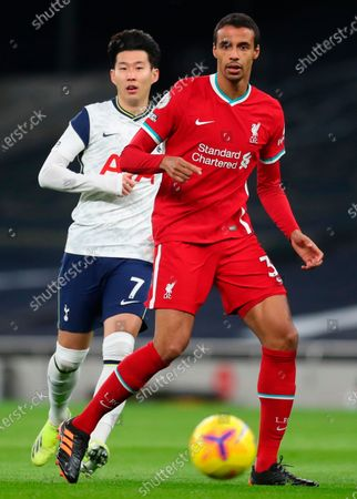 Stock Photo of Liverpool's Joel Matip (R) in action against Tottenham's Son Heung-Min (L) during the English Premier League soccer match between Tottenham Hotspur and Liverpool FC in London, Britain, 28 January 2021.