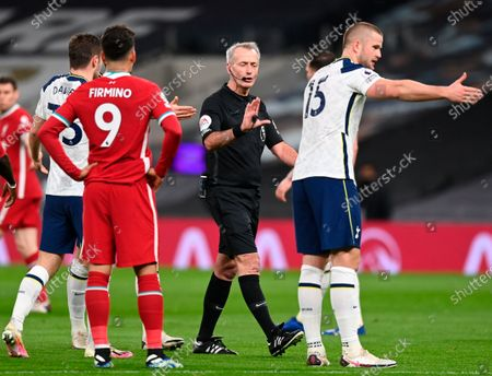 Tottenham's Ben Davies (L) talks to referee Martin Atkinson (C) during the English Premier League soccer match between Tottenham Hotspur and Liverpool FC in London, Britain, 28 January 2021.