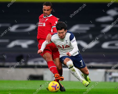 Liverpool's Joel Matip (L) in action against Tottenham's Son Heung-Min (R) during the English Premier League soccer match between Tottenham Hotspur and Liverpool FC in London, Britain, 28 January 2021.