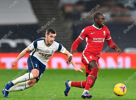 Liverpool's Sadio Mane (R) in action against Tottenham's Harry Winks (L) during the English Premier League soccer match between Tottenham Hotspur and Liverpool FC in London, Britain, 28 January 2021.