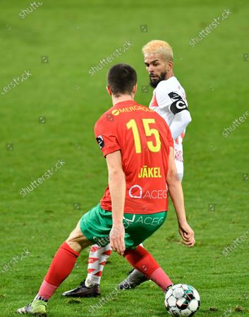 Standard's Mehdi Carcela and Oostende's Frederik Jakel fight for the ball during a soccer match between KV Oostende and Standard de Liege, Thursday 28 January 2021 in Oostende, on day 22 of the 'Jupiler Pro League' first division of the Belgian championship.