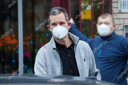 Stock Picture of Inaki Urdangarin signs autographs and takes selfies after leaving Fundación Hogar Don Orione