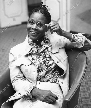 """Cicely Tyson peers through a monocle at the Dorchester Hotel in London, . Tyson, the pioneering Black actress who gained an Oscar nomination for her role as the sharecropper's wife in """"Sounder,"""" a Tony Award in 2013 at age 88 and touched TV viewers' hearts in """"The Autobiography of Miss Jane Pittman,"""" has died. She was 96. Tyson's death was announced by her family, via her manager Larry Thompson, who did not immediately provide additional details"""