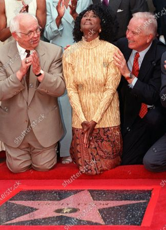 """Academy Award-nominated actress Cicely Tyson reacts to the unveiling of her star on the Hollywood Walk of Fame in the Hollywood section of Los Angeles, . Honorary Mayor of Hollywood and chairman of the Walk of Fame committee Johnny Grant, left, and Los Angeles Mayor Richard Riordan joined Tyson for the unveiling. Tyson, the pioneering Black actress who gained an Oscar nomination for her role as the sharecropper's wife in """"Sounder,"""" a Tony Award in 2013 at age 88 and touched TV viewers' hearts in """"The Autobiography of Miss Jane Pittman,"""" has died. She was 96. Tyson's death was announced by her family, via her manager Larry Thompson, who did not immediately provide additional details"""