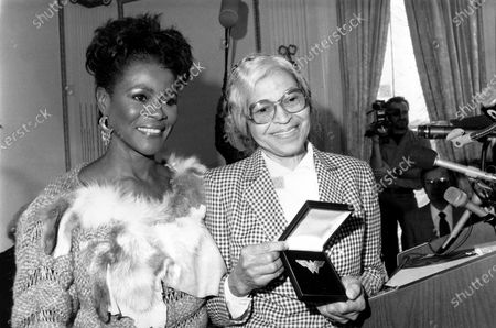 """Actress Cicely Tyson, left, presents the Eleanor Roosevelt Woman of Courage Award from the Wonder Woman Foundation, Inc., to Rosa Parks on . Tyson, the pioneering Black actress who gained an Oscar nomination for her role as the sharecropper's wife in """"Sounder,"""" a Tony Award in 2013 at age 88 and touched TV viewers' hearts in """"The Autobiography of Miss Jane Pittman,"""" has died. She was 96. Tyson's death was announced by her family, via her manager Larry Thompson, who did not immediately provide additional details"""