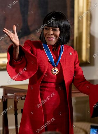 """Stock Photo of Actress Cicely Tyson blows a kiss after receiving the Presidential Medal of Freedom from President Barack Obama during a ceremony in the East Room of the White House, in Washington. Tyson, the pioneering Black actress who gained an Oscar nomination for her role as the sharecropper's wife in """"Sounder,"""" a Tony Award in 2013 at age 88 and touched TV viewers' hearts in """"The Autobiography of Miss Jane Pittman,"""" has died. She was 96. Tyson's death was announced by her family, via her manager Larry Thompson, who did not immediately provide additional details"""