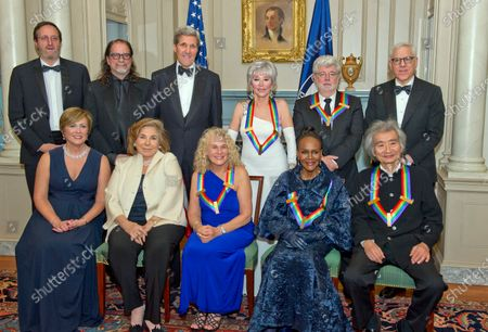 The five recipients of the 38th Annual Kennedy Center Honors pose for a group photo following a dinner hosted by United States Secretary of State John F. Kerry in their honor at the U.S. Department of State in Washington, D.C.. The 2015 honorees are: singer-songwriter Carole King, filmmaker George Lucas, actress and singer Rita Moreno, conductor Seiji Ozawa, and actress and Broadway star Cicely Tyson. From left to right top: Ricky Kirshner; Glenn Weiss; United States Secretary of State John Kerry; Rita Moreno; George Lucas; and David M. Rubenstein, Chairman, John F. Kennedy Center for the Performing Arts. From left to right bottom: Deborah F. Rutter, President, John F. Kennedy Center for the Performing Arts; Teresa Heinz-Kerry; Carole King; Cicely Tyson; and Seiji Ozawa.