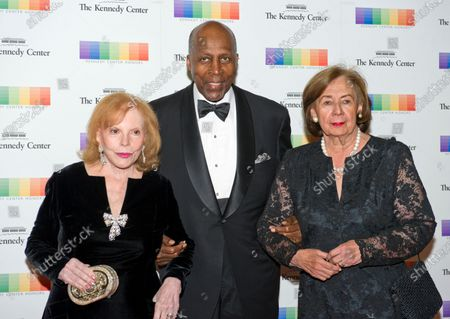 Buffy Cafritz, Vernon Jordan, and Ann Jordan arrive for the formal Artist's Dinner honoring the recipients of the 38th Annual Kennedy Center Honors hosted by United States Secretary of State John F. Kerry at the U.S. Department of State in Washington, D.C.. The 2015 honorees are: singer-songwriter Carole King, filmmaker George Lucas, actress and singer Rita Moreno, conductor Seiji Ozawa, and actress and Broadway star Cicely Tyson.